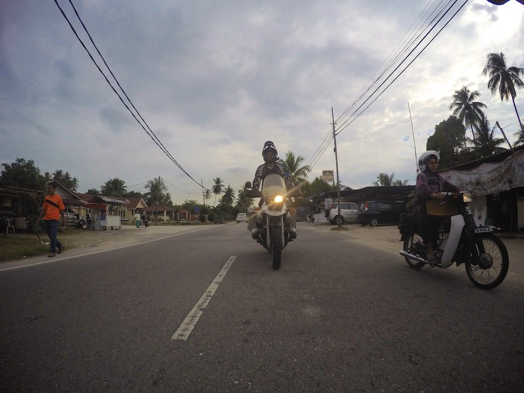 Riding through a small town in Penang