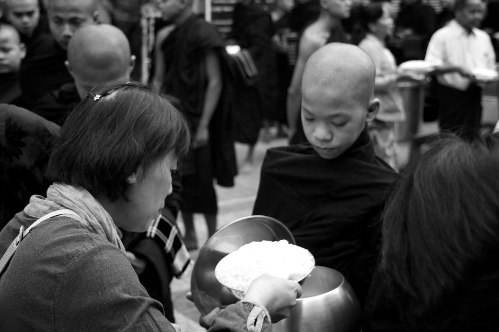 Novice monks receiving their food donations