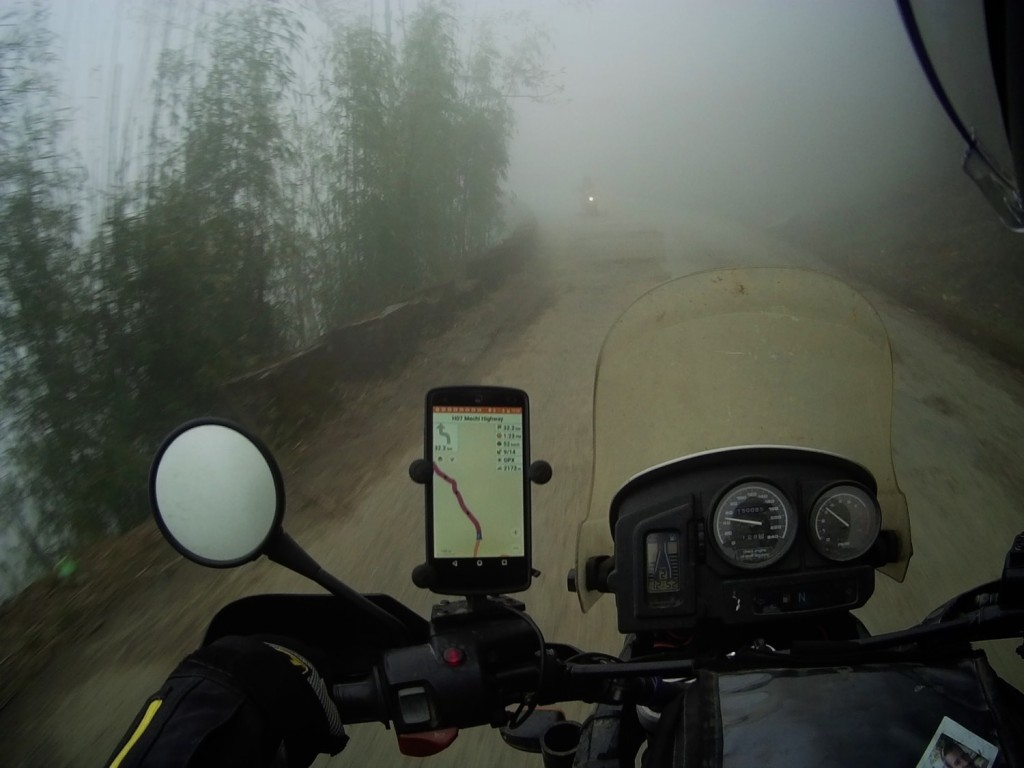 Riding through the clouds in the Himalayas. Drew is not more than 50 metres in front