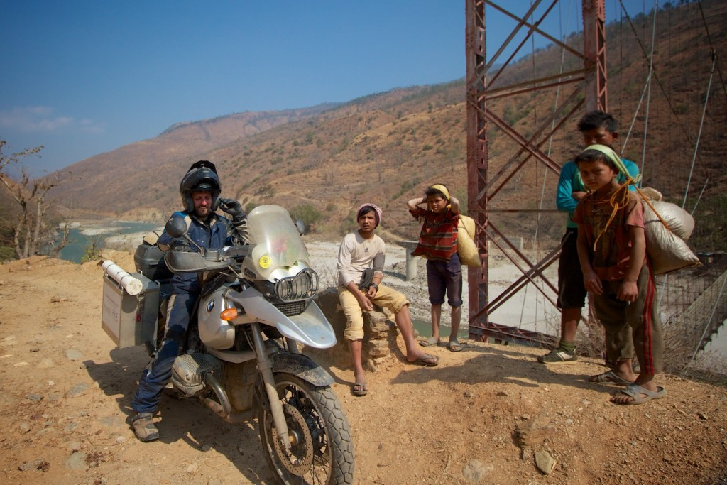 These locals helped carry our gear across the bridge after we got the bikes across.
