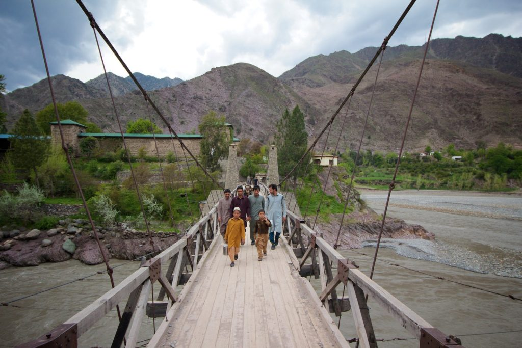 Locals crossing the bridge to Nagar Fort