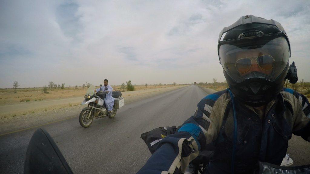 Policeman in pyjamas riding Drew's bike, when James was too sick to ride himself